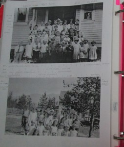 Two black and white photographs in a binder