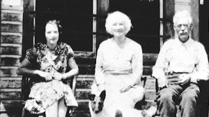 Edna Daney (nee Lindholm), Elizabeth Jowett, and John Simpson on the porch of the Windsor Hotel at Trout Lake City, ca. 1930s.
