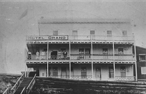 Grand Hotel, Nakusp, ca. 1920, with group posing on balcony. L-R: Mrs. Frank Hughes, Rose Labrash, Mrs. Labrash, Lila Labrash, ?, ?.